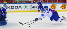 Flight for the puck Nathan Di Casmirro (front) of Italy and Donghwan Kim (back) of South-Korea fight for the puck during the Division I Group A Ice Hockey World Championships in Budapest, Hungary on April 14, 2013.