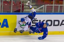 Fierce fight Roman Savchenko (L) of Kazakhstan and Robert Dowd (R) of Great Britain fight for the puck during the Division I Group A IIHF Ice Hockey World Championships in Budapest, Hungary on April 15, 2013.