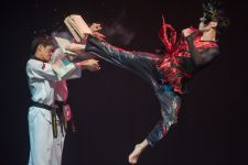 Flying kick Martial artists perform during the TAL extreme taekwondo theatre show from Korea performing in Budapest, Hungary on September 06, 2013.