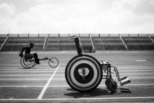 Runner with wheels  Kenyan para-athletes from Kenya national para-olympic team train with wheelchairs at the Nyayo National Stadium in Nairobi, Kenya They never paticipate paralympic games but they train every week for attend the next paralympic games.